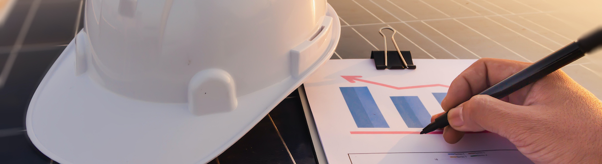 Hard hat and solar panel image