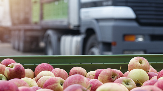 Apples with truck in the background