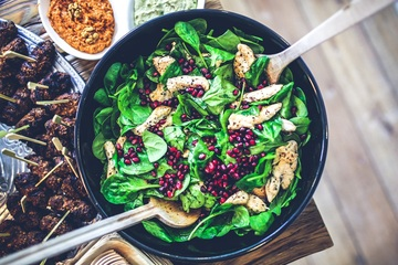 Bowl of salad with chicken and cranberries