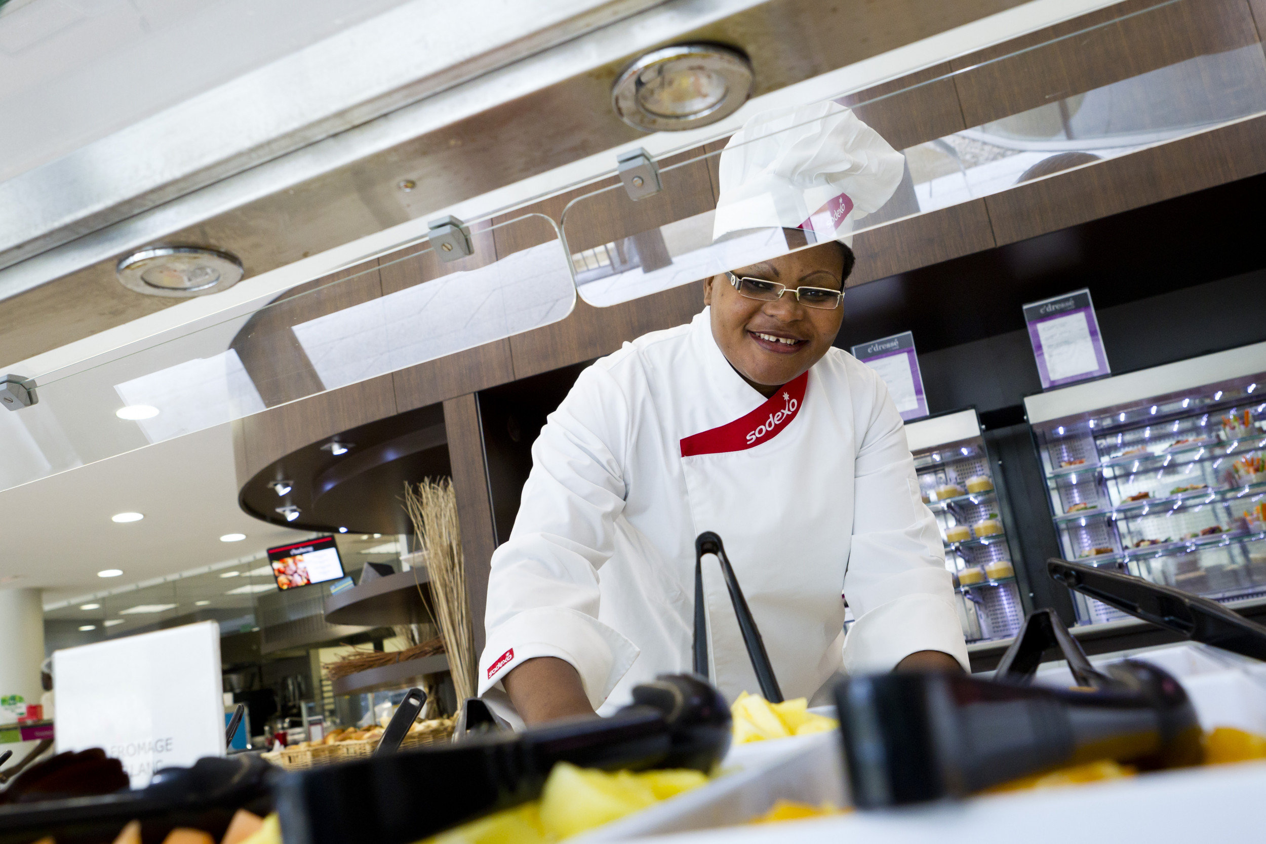 A sodexo chef preparing food